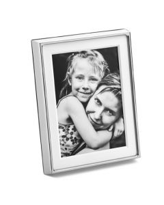 The Georg Jensen, Large Silver Deco Photo Frame features a broad white frame, polished steel edge and plastic stand back.